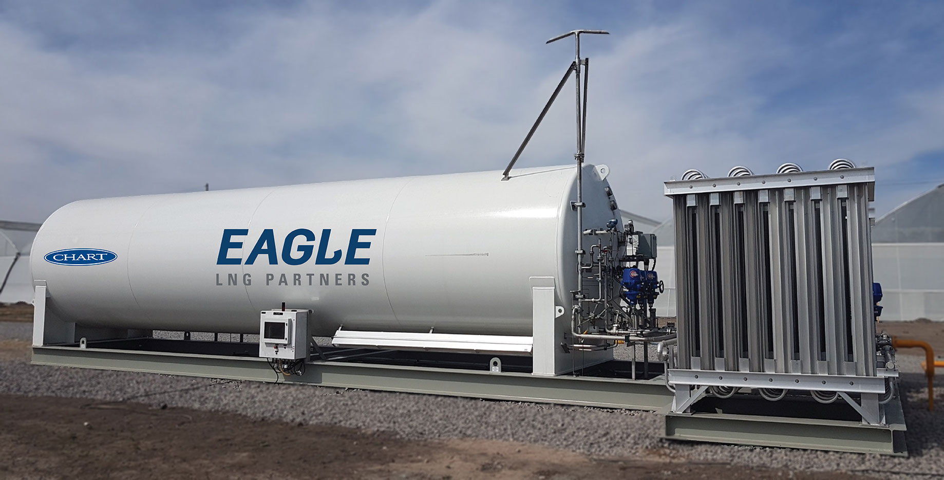 Image of a large, horizontally positioned LNG cylinder storage tank, painted bright white with the Eagel LNG logo in dark blue on the side