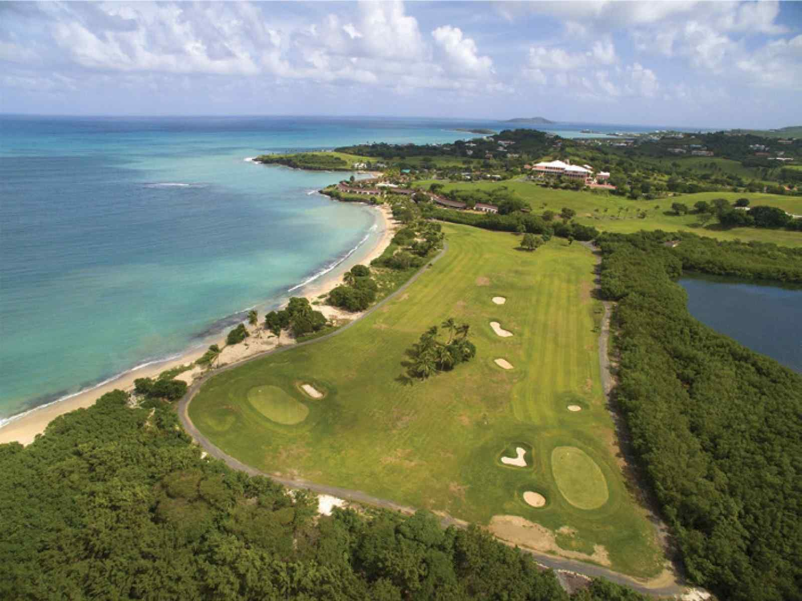 image of an aerial view of a golf course along a tropical seashore