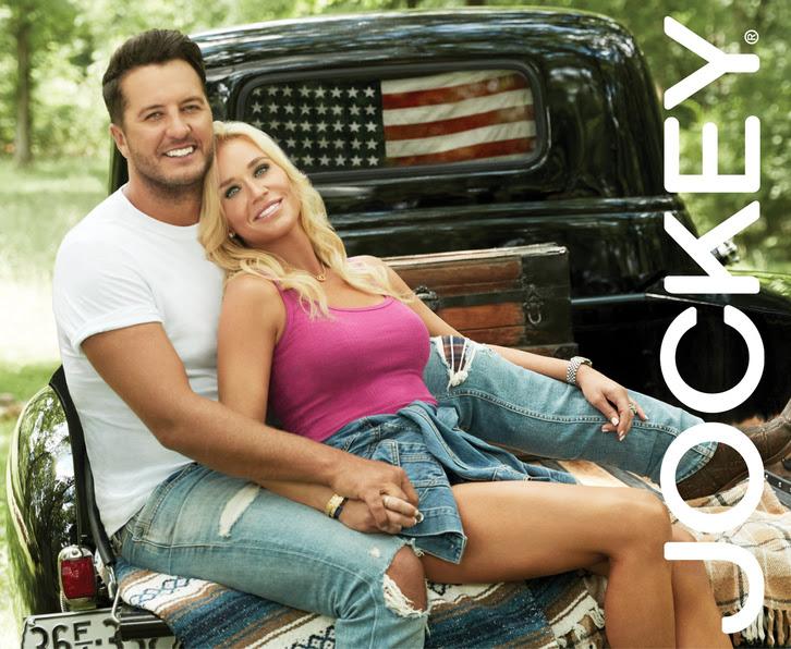 Luke and Caroline Bryan with Jockey logo in back of truck