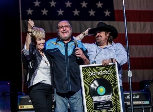The Marshall Tucker Band Surprises Daniels' Wife Hazel and Son Charlie Jr. with Plaque Commemorating One Billion Streams