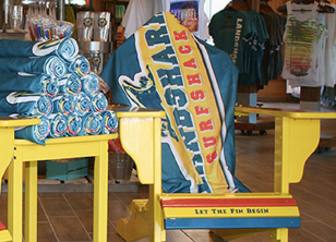Towels with Margaritaville symbolism on bright yellow chairs