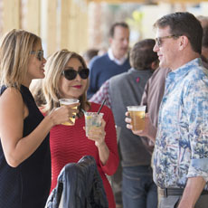 Group of people at an event with cups of LandShark Lager