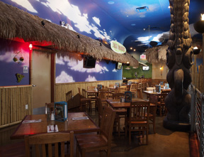 TIKI DINING interior with wooden chairs and tables