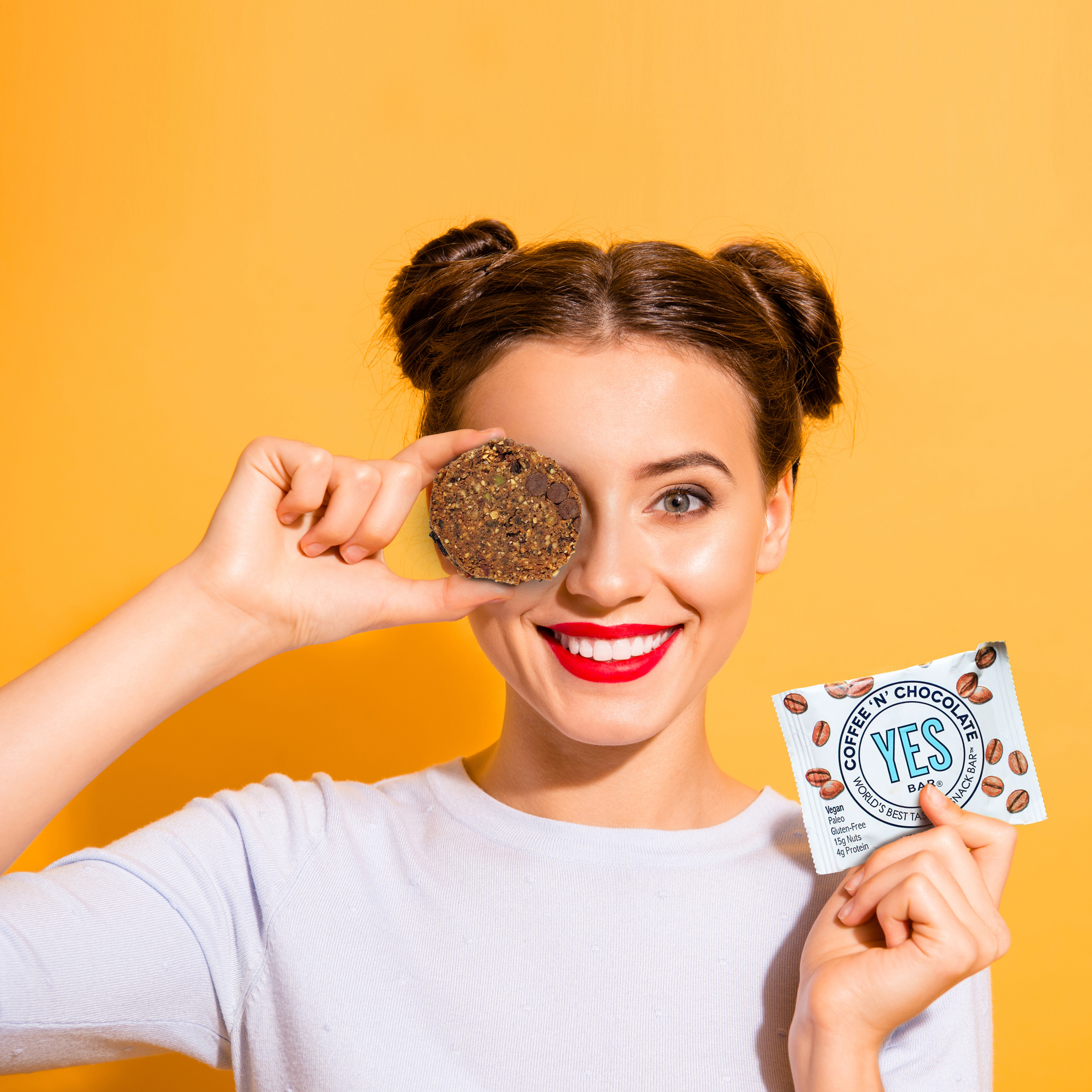 image of a woman holding a granola bar