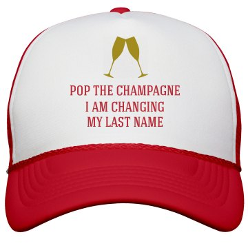 Pop the Champagne Changing my Last Name Trucker Hat