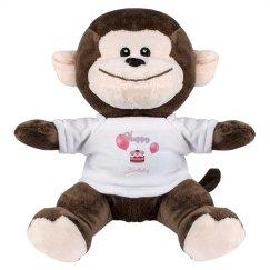 Pink Happy Birthday Cake on Monkey Stuffed Animal