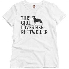 Girl loves her Rottweiler