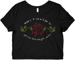 Every Rose Grows Through Dirt