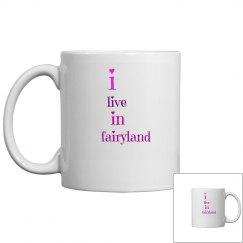 i live in fairyland mug