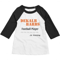 Toddler football player in training