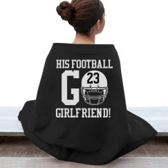 A Football Girlfriend Blanket in the Bleachers With No.