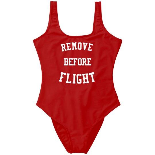 REMOVE BEFORE FLIGHT SWIMMER