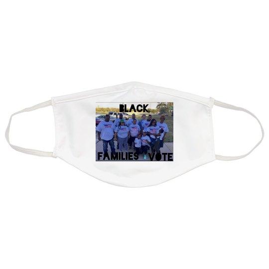 White mask w/black families vote graphic