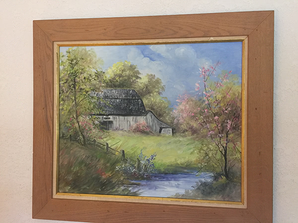A framed painting of Helen's family barn, painted by a friend from a photo.