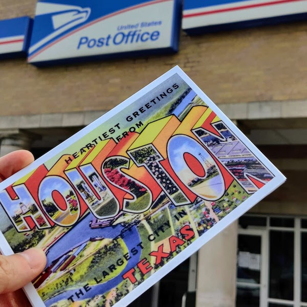 Posting a postcard at the Southmore Post Office, Houston, Texas, USA