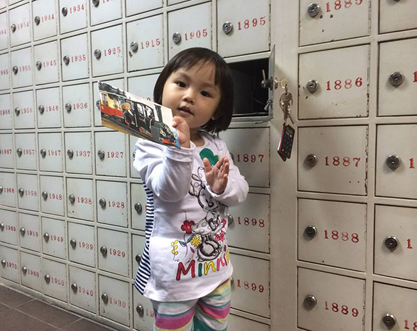Audrey picking up her postcards!