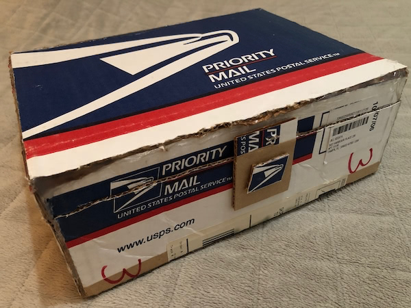 Ethan's postcard storage box, made of a repurposed USPS box