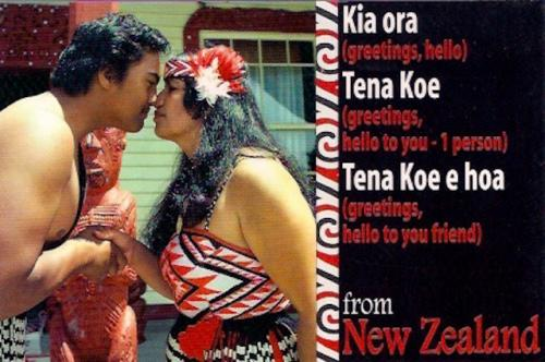 A beautiful postcard from New Zealand! I love the red/white/black patterns on the woman's dress! :D